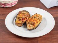 Berenjenas rellenas de tomate, queso, mozzarella y aceitunas (2 unidades)