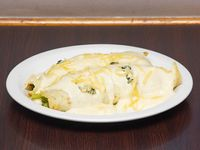 Canelones rellenos de pollo y verdura a los 4 quesos
