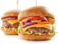 2 hamburguesas Tradicionales + Papas Medianas + Gaseosa 400 ml