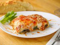 Lasagna casera de carne, espinaca, jamón y muzzarella