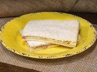 Sándwich triple especial de queso y atún