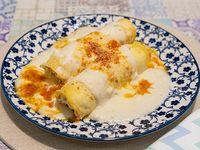 Canelones de pollo y verdura o ricota jamón con tuco o mixta
