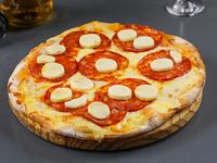 Pizzeta con muzzarella + 2 gustos