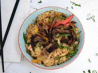 Wok de arroz y lomo