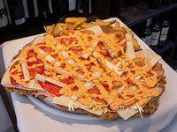 Super milanesa especial tropical con papas fritas