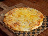 Pizza con muzzarella y orégano
