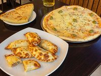 Promo 1 - Pizza con mozzarella + 6 empanadas + 2 fainá