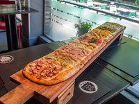 Tabla de pizzería y gustos