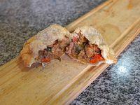 Empanada  soufle de carne cortada a cuchillo
