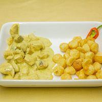 Pechuguita trozada con salsa de azafrán