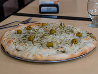 29 - Pizza fugazzetta rellena (porción)