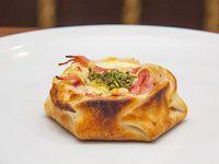 Empanada al horno de jamón y provolone