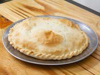 Tarta individual de queso y cebolla
