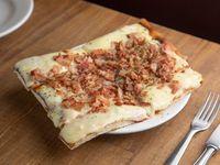 Pizza con muzzarella y un gusto (porción)