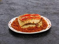 Lasagna casera de carne, jamón, muzzarella y salsa de tomate
