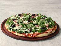 Pizza con rúcula y crudo