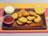 Nuggets papas fritas lata gaseosa