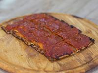 Pizza a la salsa (porción)