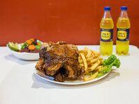 Pollo entero a las brasas + papas fritas o arroz + ensalada mixta