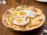 Pizzeta con cebolla y huevo