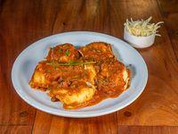 Raviolones de ricota, muzzarella y nuez con salsa a elección