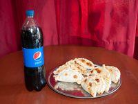 Promo - Docena de empanadas + gaseosa Pepsi 1.25 L
