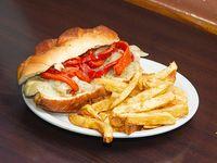Sándwich maldita vegan rock con papas fritas