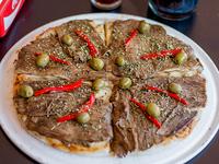 Pizza con ternera