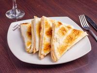 Tostado de miga jamón cocido y queso (4 Triangulos)