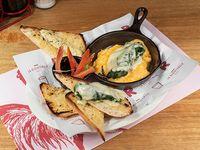 Par de huevos con espinaca y queso gratinado