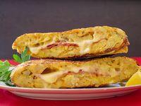 Tortilla de papa con jamón y queso