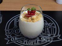 Cheesecake con coulis de frutos rojos