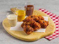 Wings al horno con salsa a elección