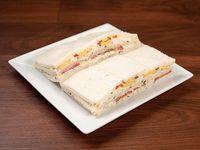 Sándwich triple de pavita