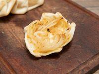 Empanada vegetariana de queso y cebolla