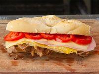 Dakar de jamón, queso, tomate y huevo