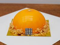 Pastel Zenith con mango y maracuyá