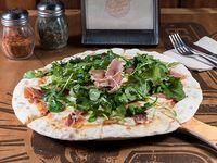 Pizza con jamón serrano y rúcula