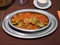 Ravioles verdes con salsa especial a elección
