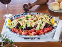 Ensalada Montecatini Pollo grillado, mix de Verdes, Huevo, Palta, Tomate Fresco y Mozzarella