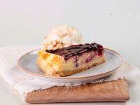 Porción Cheesecake con Helado