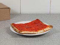 Porción de pizza común