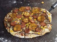 Pizza Pequeña de la Casa Club Criolla