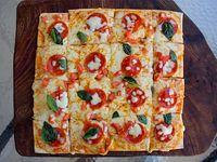 Pizza con  pepperoni mediana