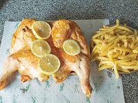 Pollo entero con papas fritas