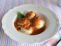 Sorrentinos con salsa fileto