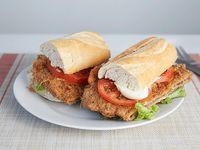 Milanesa en dos panes de carne o pollo