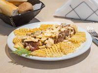 Bife de chorizo  con baño de champignones y papas españolas