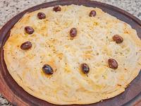 Pizza fugazzeta con jamón chica