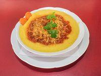 Polenta a la bologñesa con queso